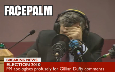 Gordon Brown hears his own words on tape and covers his face
